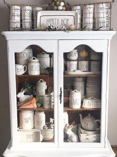 Rae Dunn display - mugs in basket