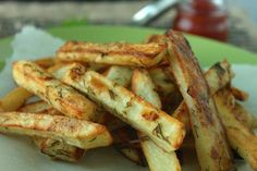 Dill Pickle Fries!  This tasty snack is salty, tangy and bursting with dill pickle flavor. If you are a fan of dill pickle chips you will love Dill Pickle Fries. Apple cider vinegar gives these fries a tangy flavor and they are seasoned with fresh dill, garlic powder and mustard powder. Enjoy these gluten free dill pickle fries hot out of the oven as a Super Bowl snack or a vegan side to any meal.