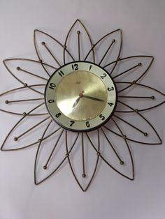 Mid Century Modern Atomic Starburst Lux Wall Clock.