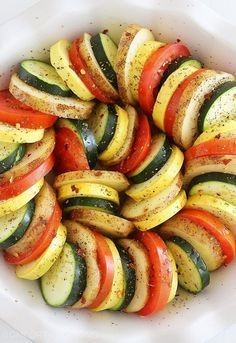 Parmesan Vegetable Tian – Our all-time favorite side dish! Layered potatoes, zucchini, tomatoes and squash, baked 'til tender & crisp with a cheesy Parmesan topping. Healthy, colorful and delicious on the side of roasted meats!   thecomfortofcooking.com