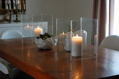 Glass-Candle-Hurricanes by The Art of Doing Stuff,  use glass from Dollar Store and marine silicone to fasten together.