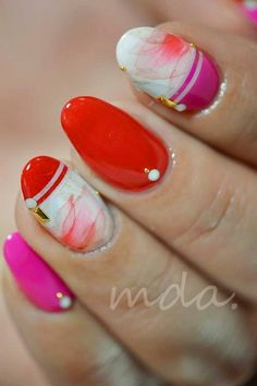 So pretty! Pink and red nail art with a high gloss top coat. Yuck on the rounded tips; square tips with rounded edges would better compliment the glossy look.