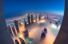 Daniel Cheong's surreal cityscape photos capture some of the world's tallest skyscrapers engulfed in mist. The photographer stakes out incredible vantage points in the city of Dubai to shoot the tops. Dubai Hotel, Dubai City, Dubai Skyscraper, Dubai Buildings, Skyscrapers, Modern Buildings, Beautiful World, Beautiful Places, Abou Dabi