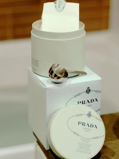 Prada logo is simple and beautiful, makes the product seem clean and chic