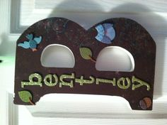 Wooden letter, with adhesive applied paper and decor.