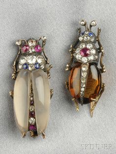 Antique gem-set Insect Brooches, with citron and moonstone bodies and ruby and sapphire melee, with old mine and rose-cut diamond accents, silver and gold mounts,