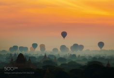 Popular on 500px : cenic sunrise with many hot air balloons above Bagan in Myanmar by Anek2910