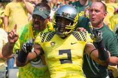 Game #2 Oregon Ducks defensive back Tyree Robinson (2) jumps into the crowd after running through the tunnel onto the field. The No. 3 Oregon Ducks play the No. 7 Michigan State Spartans at Autzen Stadium in Eugene, Oregon on Sept. 6, 2014. (Taylor Wilder/Emerald)