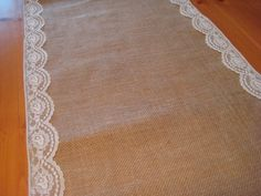 this idea of lace on the burlap runner is sweet.   Rustic Wedding Decor Burlap Runner. $15.95, via Etsy.