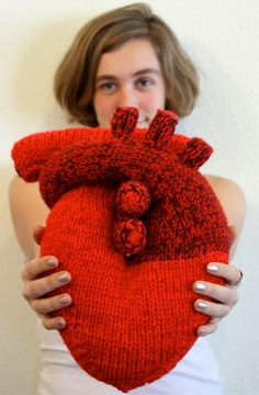 Anatomical hand knitted heart pillow by The Teary Seal