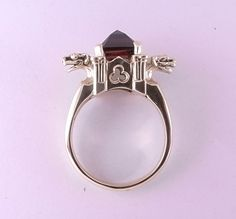 9ct Yellow Gold Gargoyle and Cathedral Ring with Garnet Stone. $750.00, via Etsy.