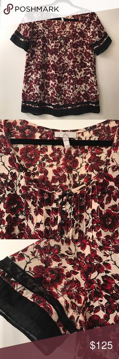 Joie floral blouse Short sleeve black, red & cream floral blouse; ruffled sleeves and bottom, black buttons; like new, never worn. 100% silk Joie Tops Blouses