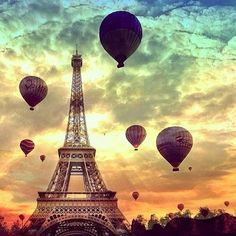 hot air balloons and the Eiffel Tower at sunset
