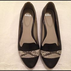 Classic black Flats with snake skin *brand new* Gorgeous black flats,very well made. Great for work shoes *Brand new without box Shoes Flats & Loafers