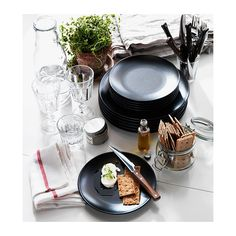 DINERA 18-piece service IKEA With its simple shapes, muted colours and matt glaze, the dinnerware gives a rustic feel to your table setting....