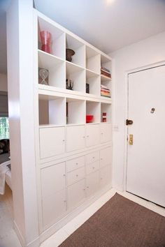 how to make an entryway have more storage and function when it is right off of the living room. Define the front door using Ikea. Photo source Apartment Therapy