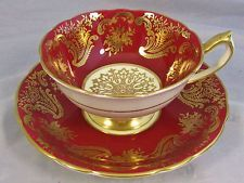 PARAGON RED GOLD GILT SCROLLED FLORAL DESIGNS TEA CUP AND SAUCER