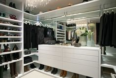 ♔ this dressing room has a mirrored backing, built in accessory island, dripping chandelier & good use of space in the shoe storage below....
