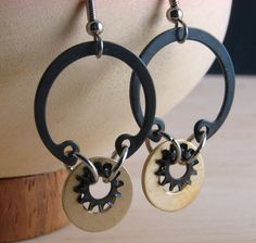 Try these sleek steampunk dangle earrings for a modern elegant look. Lightweight enough to wear all and and night.  Created with a 7/8 (2.3 cm)
