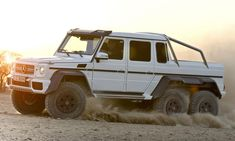 The G63 6x6 is powered by the G63's twin turbo V8. That equals 536 horsepower and 560 pound feet of torque. The torque split betwixt all six wheels is a nice 30:40:30. That adds up to 0 to 60 in under six seconds and a top speed of 100 MPH. That might sound slow, but it has 37 inch tires and weighs, wait for it, 8,322 pounds.