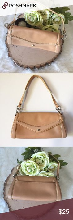 Cole Haan Leather Purse Tan smooth leather with silver accents. Snaps close. Inside pocket. Lining clean although there is a small AE written on the inside. Otherwise it looks unused. See photos. Cole Haan Bags
