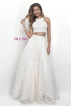 8cda8e0da346 Pink by Blush 5600 is a trendy high neck two piece prom gown that features  a fully beaded bodice with a keyhole accent. The full skirt is overlaid  with a ...
