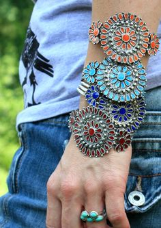 These reproduction INDIAN-style cuff bracelets are a GREAT, inexpensive way to get the SouThern-FRied HiPPIE girl LOOK!!! PleASE note . . these are CHEAP, FUN bracelets that LOOK good but have that BeAT-up look!   silver plate with resin stones.  choose your fav color! or stack em up!