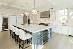 To prevent the clash of too many cooks, high-end kitchens are growing bigger and more complex.