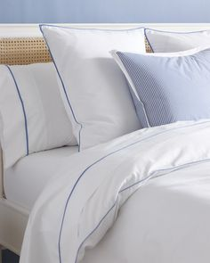 This bedding exudes beach house chic, making it the perfect addition to a coastal bedroom or rattan bed.