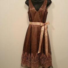 ♡ SALE ♡ Adrianna Papell Dress Beautiful brown Adrianna Papell dress with intricate details. In excellent condition. Some wrinkles from being in dress bag. This is a very beautiful dress on. Guaranteed to steal the show. Shell is 100% polyester Top Lining is also 100% polyester and the Under Lining is 100% acetate.  Bundle for a 15% Discount   Thanks for shopping! Adrianna Papell Dresses