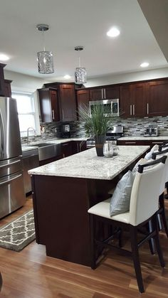 Dark wood with granite counters