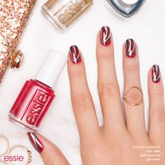 Get 'Holiday Ready' with a nail art look that will top of your look and will have you dressed to the nines. Recreate this festive essie nail design using nail polish colors from the essie winter 2016 collection. Start with your favorite base coat and then by applying 2 coats of 'party on a platform', a london garnet red nail lacquer. Then create swirls with peacock blue 'satin sister' and metallic gold palladium 'getting groovy'. Top off your mani with gel.setter top coat and you're good to…