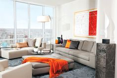 This living room draws inspiration from the urban city surround. #orange accents #homedecor