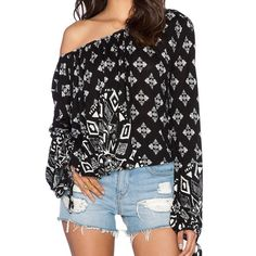 Free People B&W Printed Top New without tags. Bought this top but never wore it. Flowy long-sleeve top that you can wear off the shoulder. Free People Tops Tees - Long Sleeve
