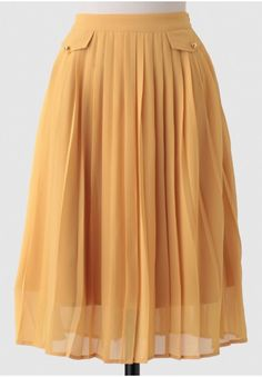 Create a variety of adorable ensembles with this chiffon mustard-hued midi skirt featuring darling pleating and faux front pockets accented with gold-toned buttons. By Dear Creatures.