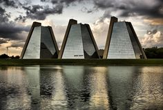 The Pyramids are three pyramid-shaped office buildings that are part of a 200-acre commercial development in College Park, Indianapolis, Indiana. The structures occupy 45 acres of land situated next to a 25-acre lake. They were constructed between 1967 and 1972 by the College Life Insurance Company using a design by famed architect Kevin Roche.