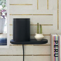 """Sonos on Instagram: """"The all-new Sonos Shelf was custom-designed for your #Sonos One and Play:1 speakers.  Using the same material, color, and finish as Sonos…"""" Play 1, Sonos, Planter Pots, Custom Design, Shelves, It Is Finished, Speakers, Diy, Instagram"""