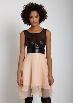 Interesting combination of leather and a feminine skirt bottom to this dress!!