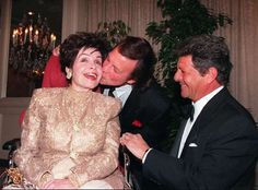 Funicello is kissed by actor Fabian while Frankie Avalon looks on during a tribute honoring Funicello in Beverly Hills in 1997.