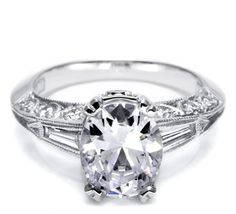 Elegance and opulence come together with this engagement ring for an oval-shaped diamond. The band tapers with fans of baguettes, sharp hand-engraved signature Tacori flourishes and lacey crescent silhouette details along the sides of the band.