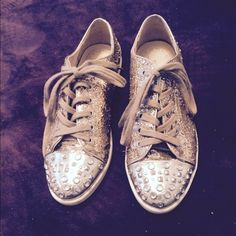 Gorgeous sneakers from Saks Boutique 9 Toe is silver with silver rhinestones. Body of sneaker is in gold metallic. Laces are beige. Hardly worn. Size 5 but fit like a true size 6 Saks Boutique 9 Shoes Sneakers
