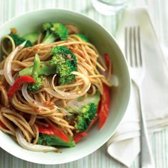Whole-wheat spaghetti complements the zesty sauce while adding fiber. A little less peanut butter plus a lot more vegetables make this a no-guilt meal.