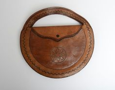 "In Uk, 10"" D, zipper pocket interior of which edge is ripped. 1930's Round Leather Woven Clutch Bag by JuneGeorge on Etsy"