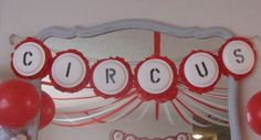 this is a great inexpensive idea for a circus sign. take the back of a paper plate, print circus on it then glue streamers to the back.