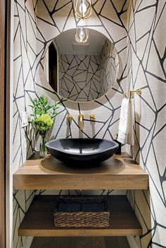 A powder room with unique textures of geometric patterns and a black stone basin. A powder room with unique textures of geometric patterns and a black stone basin. Powder Room Vanity, Powder Room Wallpaper, Powder Room Decor, Powder Room Design, Rustic Powder Room, Geometric Wallpaper Powder Room, Bold Wallpaper, Powder Room Mirrors, Hart Wallpaper