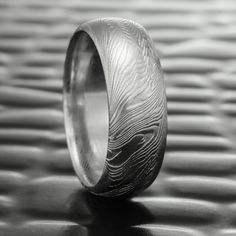 those looking for a damascus ring with a lifelike woodgrain pattern need look no further than our fine wood design this 8mm wide wedding band shows