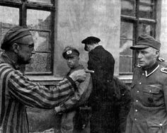 AMAZING HISTORIC PHOTOS!  This image was taken on April 14th, 1945 when the US Army liberated Buchenwald camp.  A Russian inmate can be seen identifying a Nazi guard who was particularly cruel towards the prisoners.  Buchenwald was the largest concentration camp built on German soil.  It housed prisoners from all over Europe as well as the Soviet Union.  Estimates place Buchenwald's death toll at around 56,000 people.  Follow us on our quest to make Facebook more educational in 2018.