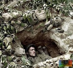 """the_ww2_memoirs Two American soldiers rest in their foxhole just outside of St. Lô, a key town in the Allied Operation to take Normandy, mid-July, 1944. They are surrounded by their ammunition and M2 """"Pineapple"""" fragmentation grenades, a truly deadly foe. In July of 1944 the Americans had advanced about 6 miles inland towards St. Lô but the """"bocage"""" country, an area of tall hedgerows and thick brush, death was a daily affair and the fighting was vicious and claustrophobic. On July 10th the…"""