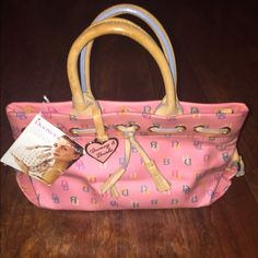 Dooney & Bourke Handbag Pink Girly Bag!! I've had this for many years. It was given as a gift, think I may have worn to church so there may be a pencil/pen marks in it. Bag has straps!! Dooney & Bourke Bags