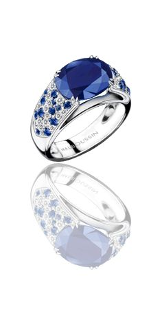 Nuit. d'Amour ring, by Mauboussin. White gold, oval Australian sapphire, sapphires and diamond pavé.